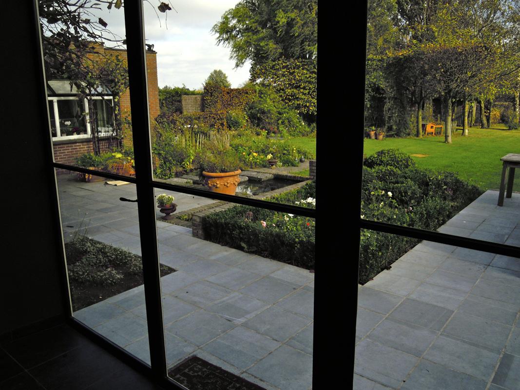 Vandekerkhove vloerwerken natuursteen opritten steentapijt terrassen vloeren - Buiten terrassen ...
